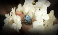 A blue ring and white flowers
