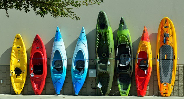 A lineup of colourful kayaks