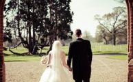 A bride and groom in a carriageway