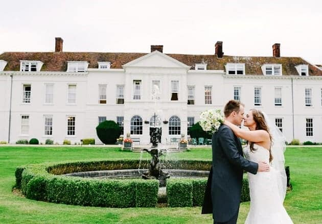 A couple kissing at Gosfield Hall