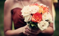 Holding a bouquet at a wedding