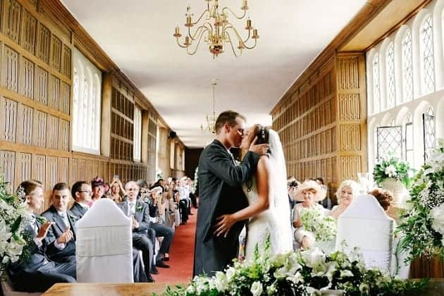 Bride and groom kissing at Gosfield Hall