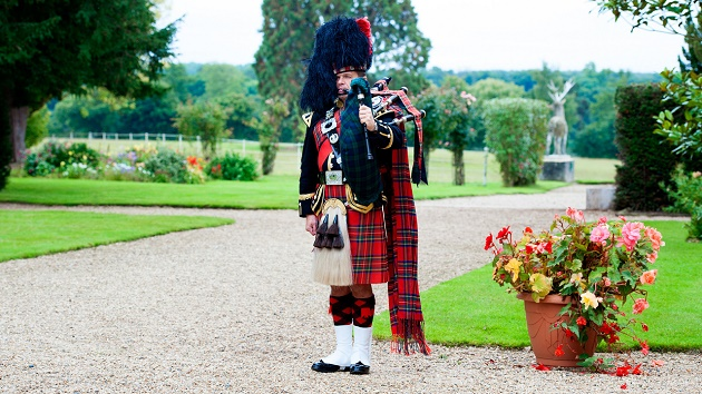 Bagpiper at Gosfield Hall