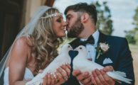 Bride and groom holding doves